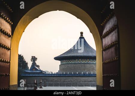 A view from a gate of a traditional chinese pagoda with blue roof at the Temple of Heaven, an imperial complex of religious buildings situated in the