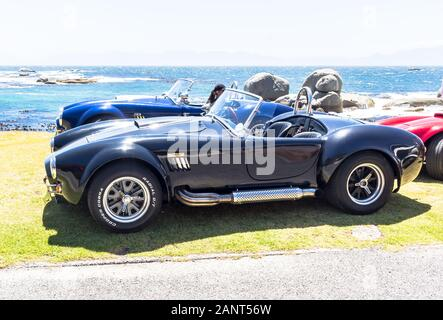 SIMONS TOWN, SOUTH AFRICA - DECEMBER 31 2010: Cobra Shelbys for hire parked near Simon's Town ready to take sight seers and adrenaline junkies for a d - Stock Photo