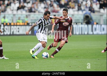 Turin Italy, 29 September 2013, 'Stadio Olimpico Grande Torino' Stadium, Campionato di Calcio Seria A 2013/2014,  FC Torino - FC Juventus: Carlos Tevez during the match - Stock Photo