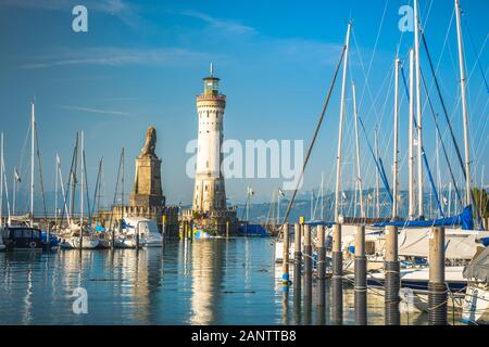 Lindau, Germany, July 2019 - Harbour entrance of Lindau, Lake Constance - Bodensee - with the new lighthouse and the Bavarian Lion. The Lindau