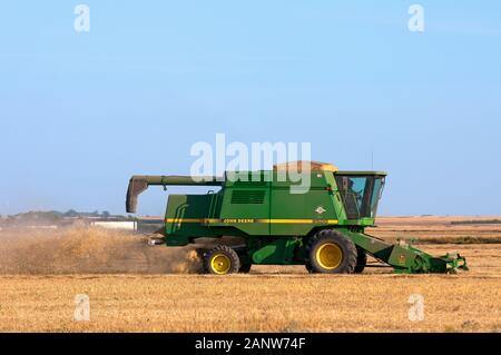 Combine harvester in a field, Saskatchewan, Canada - Stock Photo