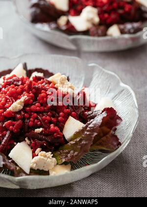 Shoestring Beets with Pearl Couscous and Pears - Stock Photo