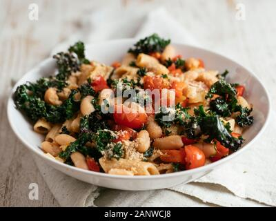 Kale (var. Lippische Palme), Pasta and White Beans in a bowl. - Stock Photo