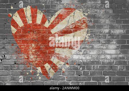 Grunge distressed heqart shaped flag of Japan painted on old weathered grey brick wall - Stock Photo