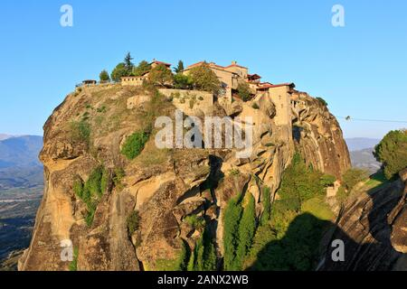 Two priests on their way in a cable car to the 14th-century Monastery of Great Meteoron at Meteora, Greece - Stock Photo
