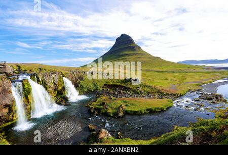 Kirkjufellfoss at Sunrise, Iceland. The fall also known as Church Mountain Falls located at  Kirkjufell mountain on the west side of Iceland. - Stock Photo