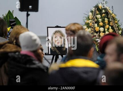 People react during a memorial service for the 11 Ukrainians who crashed in Iran at the Boryspil International Airport, not far from Kiev.Bodies of Ukrainian citizens, 9 crew members of the Ukraine International Airlines (UIA) and 2 passengers, were delivered from Iran to Ukraine on 19 January 2020. Boeing 737-800 of the Ukraine International Airlines Flight 752 (PS752) was shot down shortly after taking-off from Tehran Imam Khomeini International Airport in Iran on 8 January, 2020. All 176 people including 167 passengers and 9 crew members were killed. - Stock Photo