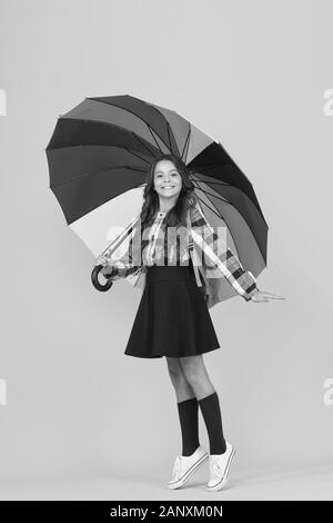 No rush. happy child protected rain. rainbow colors. color up life. school time. good weather forecast. under my umbrella. small girl colorful umbrella. bright autumn style. stay positive any season. - Stock Photo