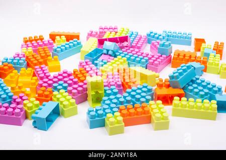 multi colored blocks of a children designer scattered on a white background. - Stock Photo
