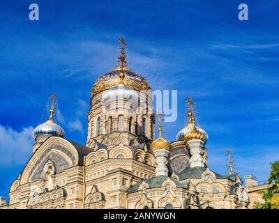 18 September 2018: St Petersburg, Russia - Church of the Assumption of Mary, on the Neva Embankment, detail of the fantastic architecture and the onio - Stock Photo
