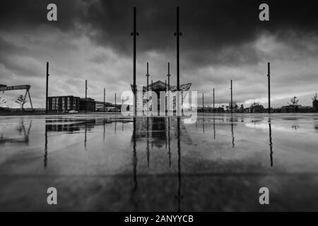Titanic Belfast reflected in the Olympic yard, Belfast, Northern Ireland - Stock Photo