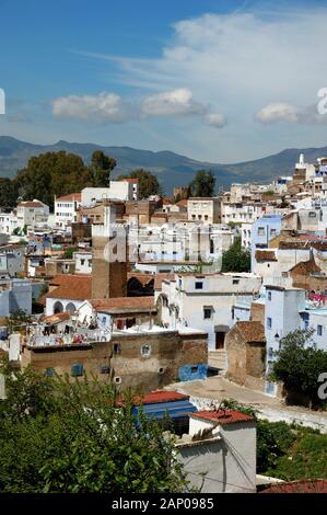 Panorama or Panoramic View over the Rooftops of the Old Town of Chefchaouen Morocco - Stock Photo