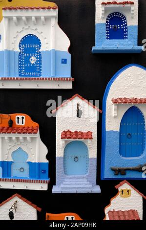 Plaster Souvenirs or Fridge Magnets of Moroccan Doors For Sale in Gift Shop or Tourist Shop Chefchaouen or Chaouen Morocco