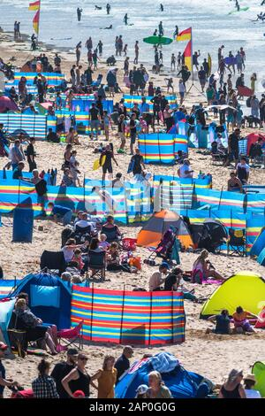 Holidaymakers enjoying themselves on Fistral Beach in Newquay in Cornwall.