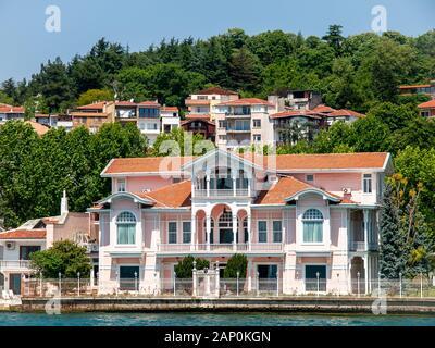 Villa Burhanettin Efendi, Yenikoy, mansions along the Bosporus Strait in Turkey a  bright summer day. View from cruise ship. - Stock Photo