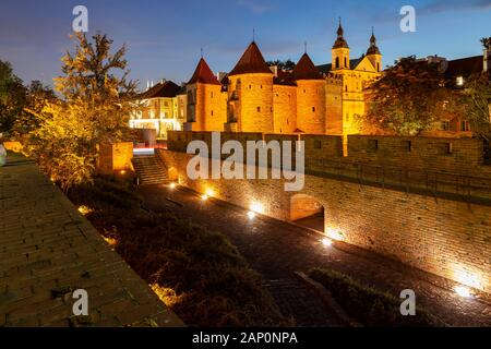 Evening at the Barbican and city walls in Warsaw. - Stock Photo