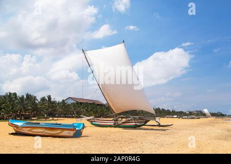 Oruwa (outrigger canoe) on Negombo beach, Western Province, Sri Lanka - Stock Photo
