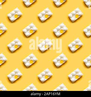 Organic white eggs in porcelain box on yellow. Abstract pattern. Seamless pattern. - Stock Photo