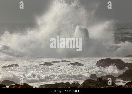 Wave splash in a rocky beach from the north of Portugal. - Stock Photo