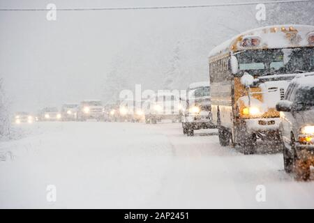 Traffic jam on a Vermont rural highway during a winter blizzard - Stock Photo