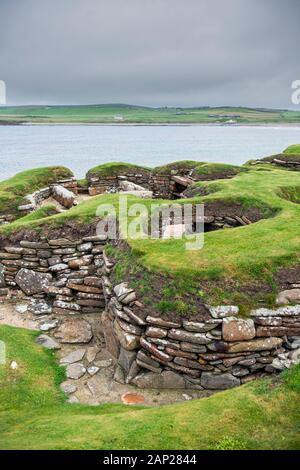 Skara Brae, a stone-built Neolithic village located on the Bay of Skaill on the west coast of the Orkney Islands in Scotland. - Stock Photo