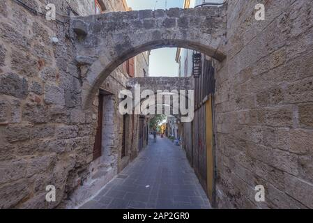 Narrow street in the medieval city inside of Fortifications of Rhodes. - Stock Photo