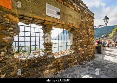 Tourists stop to enjoy the view of the Ligurian Sea on the walking path between the old and new sections of Monterosso Al Mare, Cinque Terre, Italy - Stock Photo