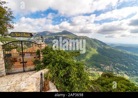 View of the mountains and valleys of the Alpes-Maritimes area of Southern France from a restaurant in the medieval village of Gourdon, France. - Stock Photo