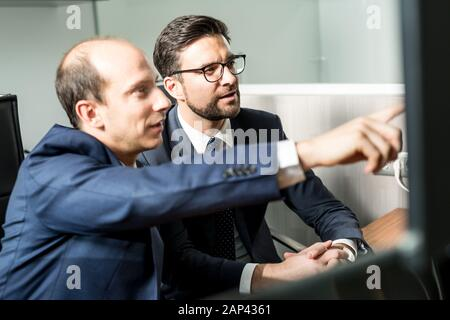 Business team analyzing data at business meeting in modern corporate office. Stock Photo