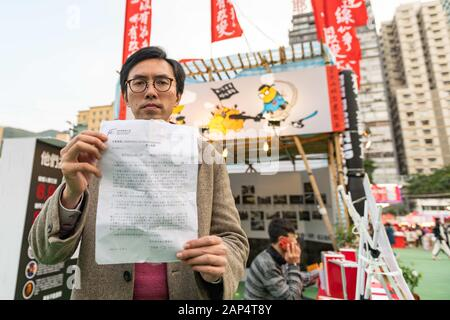 January 20, 2020, Hong Kong, Hong Kong, China: Clayton Ng shows a notice received from the Hong Kong Food and Enviromental Hygine Department that stated that a stall that was set up at the Lunar New Year Festival at Victoria Park must be taken down. (Credit Image: © Tyler Tomasello/ZUMA Wire) - Stock Photo