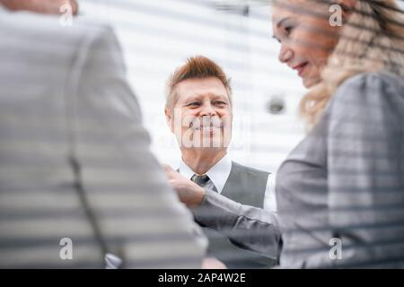 close up. senior businessman talking to his colleagues. - Stock Photo
