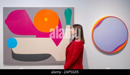 Business Design Centre, Islington, London, UK. 21st January 2020. London Art Fair showcases exceptional modern and contemporary art of our time, to discover and to buy. The Fair is an established destination for both museum quality modern and contemporary work, from prints and editions to major works by internationally renowned artists. Image: (Left) Stephen Ormandy, 'Guns Blazing', 2019; (Right) Jan Kalab, 'Moving Lila', 2019. Rhodes Contemporary. Credit: Malcolm Park/Alamy Live News. - Stock Photo