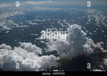 Cumulus clouds from airplane photograph from above - Stock Photo