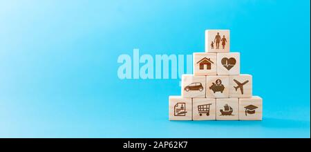 Wooden blocks with icons of various types of insurance. Life insurance concept. - Stock Photo