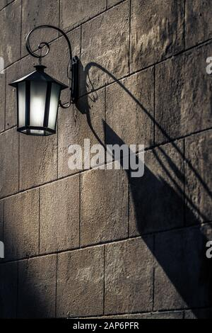 Vintage Lantern with Shadows on the wall - Stock Photo