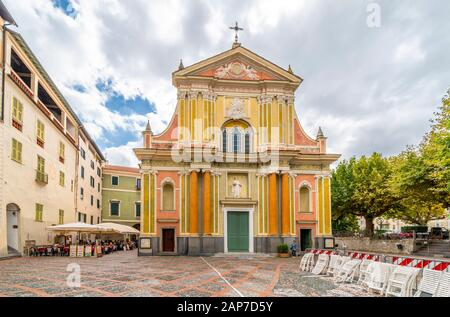 Front facade of he Sant Antonio Abate Church in a small piazza on an overcast day in Dolceacqua, Italy - Stock Photo
