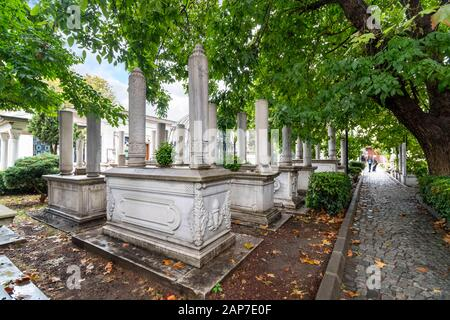The historic interior courtyard garden of the Ahmet Tevfik Paşa Tomb filled with marbled headstones, graves and memorials to Turkey's sultans. - Stock Photo