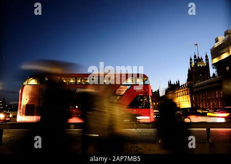 London Bus TFL Transport for London crossing Westminster Bridge dusk early evening commuters journey - Stock Photo