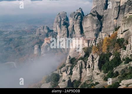 Meteora, Greece - Dec 19, 2019:  Monastery of Moni Agias Varvaras Roussanou and the spectacular massive rocky pinnacles of Meteora, Thessaly, Greece - Stock Photo