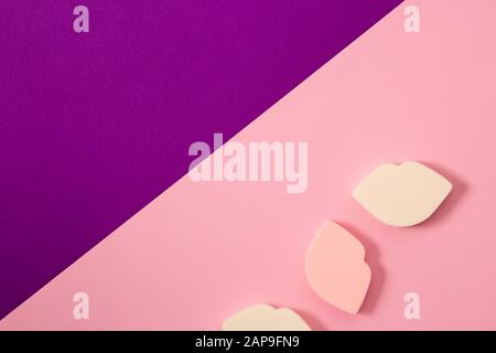 Three beautiful sponges on a two tone pink purple background. Cosmetics, makeup, beauty, fashion, youth, care concept - Stock Photo