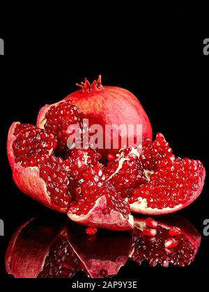 Pomegranate fruit. Pomegranates over Red Background. Organic fruits Stock Photo