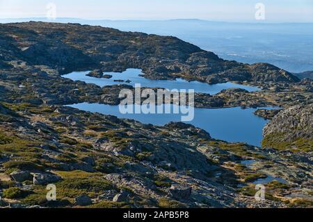 Lake in Serra da Estrela mountains from the aerial lift. Portugal - Stock Photo