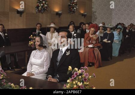 Marriage Princess Christina and Jorge Guillermo in Stadhuis in Baarn; sitting in wedding room with Royal Family and guests/Date: April 30, 1975 Location: Baarn Keywords: Royal family, marriages, town halls Personal name: Christina, princess, Guillermo, Jorge - Stock Photo