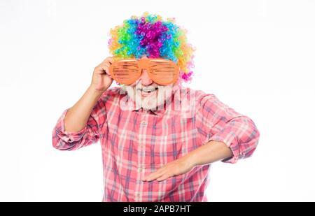 Having fun. Funny lifestyle. Fun and entertainment. Comic grandfather concept. Nice joke. Grandpa always fun. Elderly clown. Man senior bearded cheerful person wear colorful wig and sunglasses. - Stock Photo