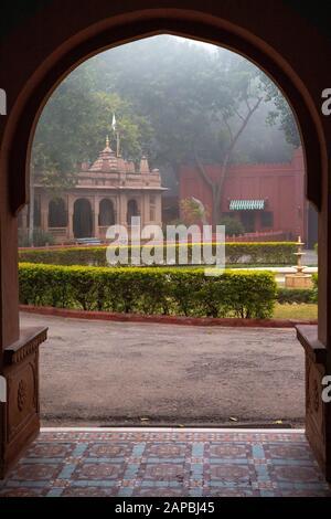 India, Rajasthan, Shekhawati, Bikaner, Gajner, Gajner Palace Heritage Hotel, former hunting lodge of Maharaja of Jaipur, Ganesh temple on misty mornin - Stock Photo