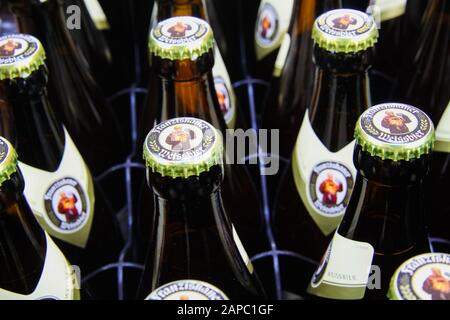 VIERSEN, GERMANY - AUGUST 21. 2019: Close up of bavarian Franziskaner wheat beer (Weissbier) bottles with crown caps in bottle case - Stock Photo