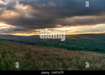 A cloudy sunset in the Yorkshire Dales near Countersett, North Yorkshire, England, UK