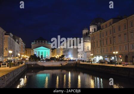 Trieste, Italien: Hafenstadt an der Adria: Canale Grande, katholische und orthodoxe Kirche - Stock Photo