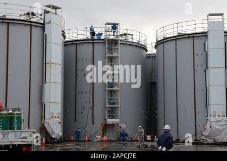 January 22, 2020, Okuma, Fukushima, Japan: Workers construct new storage tanks to store processed water in ALPS water processing system to purify contaminated water at tsunami-devastated Tokyo Electric Power Company (TEPCO) Fukushima Daiichi Nuclear Power Plant in Okuma town, Fukushima Prefecture, 22 January 2020. The storage tanks including water processed in the ALPS will be full around summer of 2022, TEPCO has told. Japanese government need to decide soon how manage the processed water still including tritium.  (Credit Image: © Kimimasa Mayama/POOL via ZUMA Wire) - Stock Photo