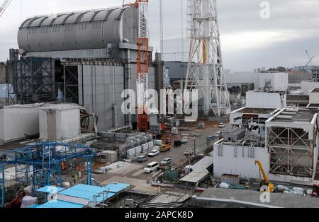 January 22, 2020, Okuma, Fukushima, Japan: Unit 3 (L) and Unit 4 (C-Rear) reactor houses are seen at tsunami-devastated Tokyo Electric Power Company (TEPCO) Fukushima Daiichi Nuclear Power Plant in Okuma town, Fukushima Prefecture, 22 January 2020. The storage tanks including water processed in the ALPS will be full around summer of 2022, TEPCO has told. Japanese government need to decide soon how manage the processed water still including tritium.  (Credit Image: © Kimimasa Mayama/POOL via ZUMA Wire) - Stock Photo